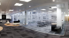 Case Study: office refurbishment, meeting rooms with faceted full height glazing and mixed flooring