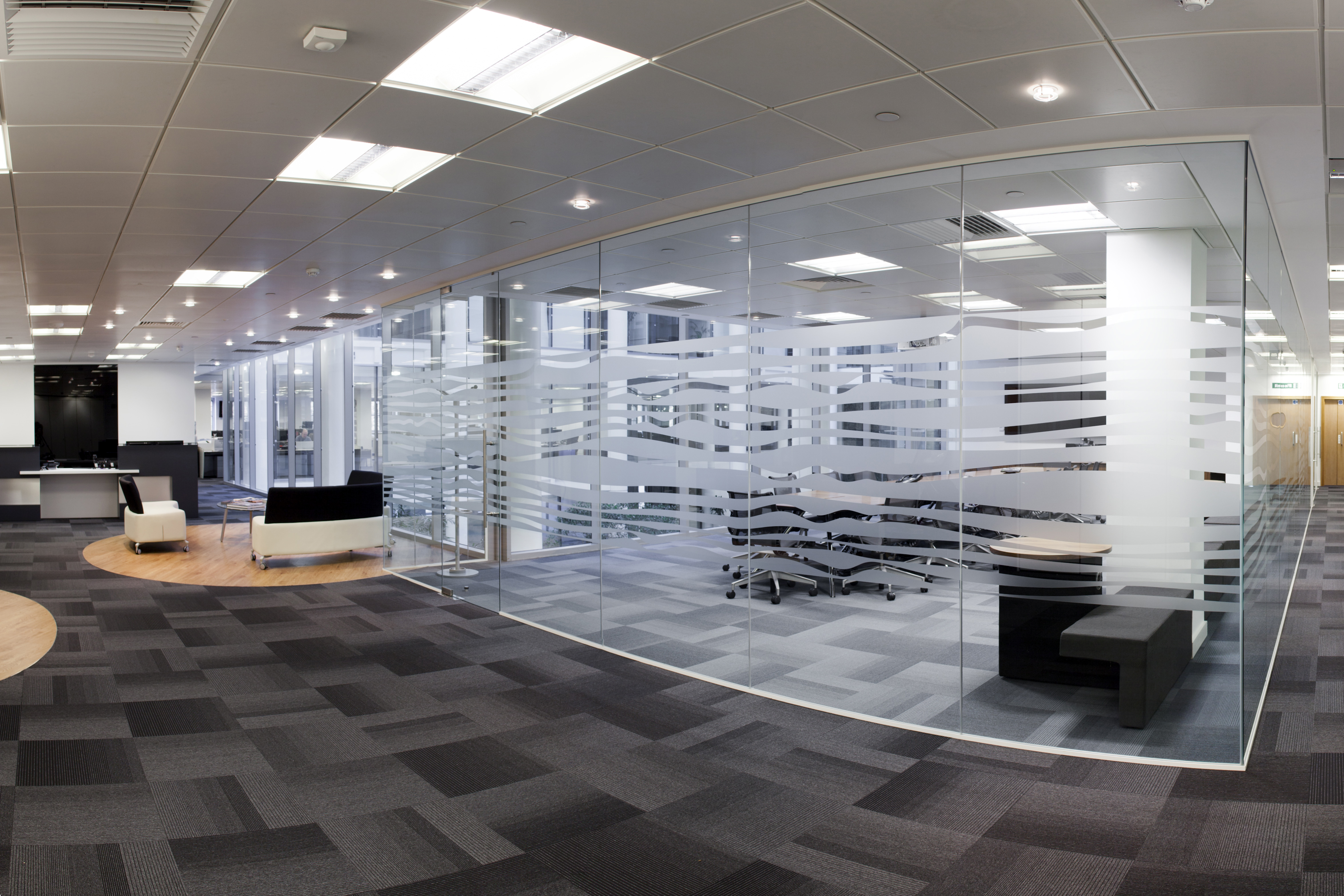 office refurbishment, meeting rooms with faceted full height glazing and mixed flooring