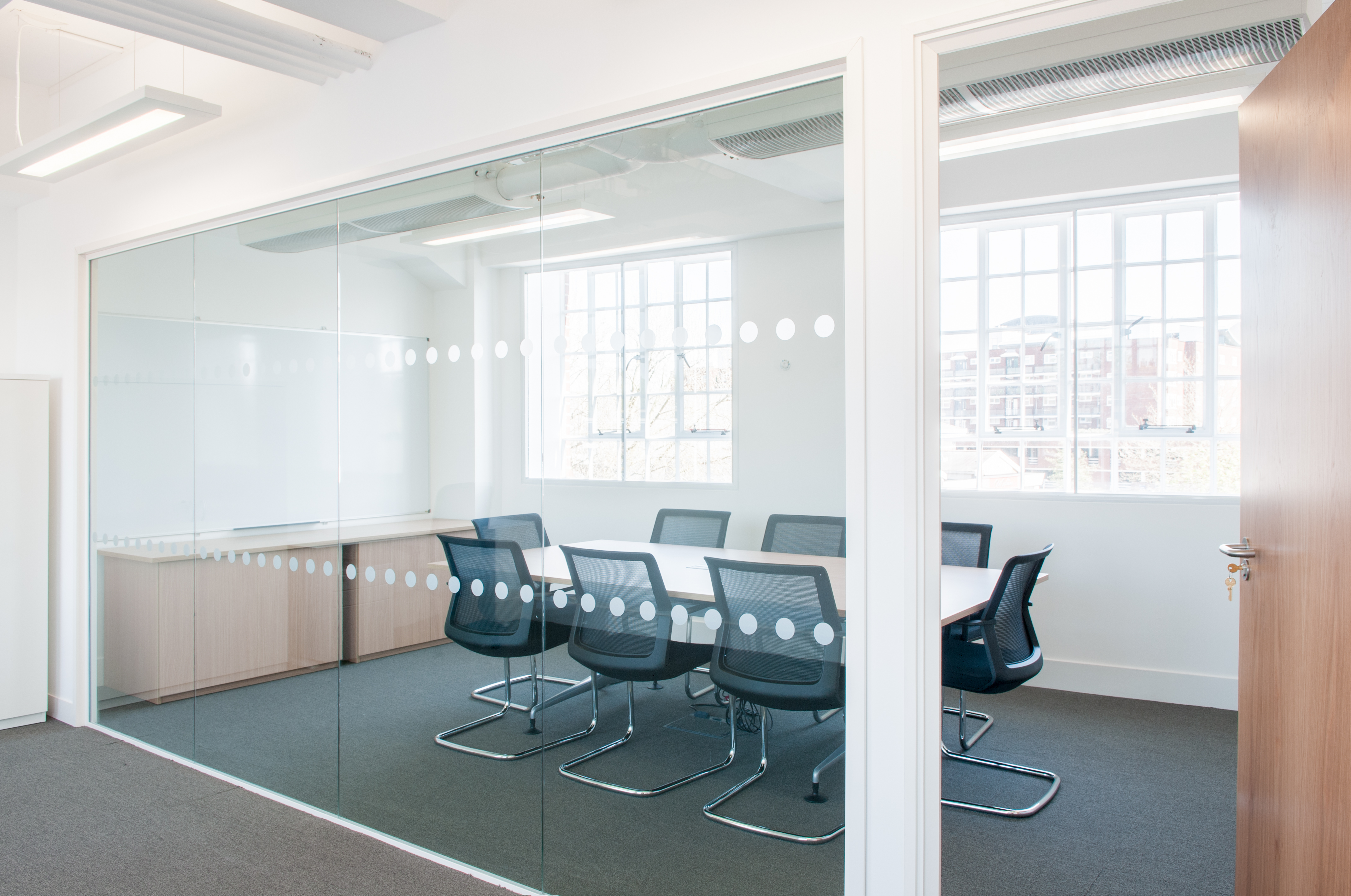 partitioned and office furnished meeting room