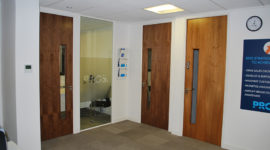 Case Study: Full height veneered solid core doors fitted with stainless steel ironmongery.