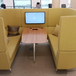 booth meeting space with integrated power and monitor