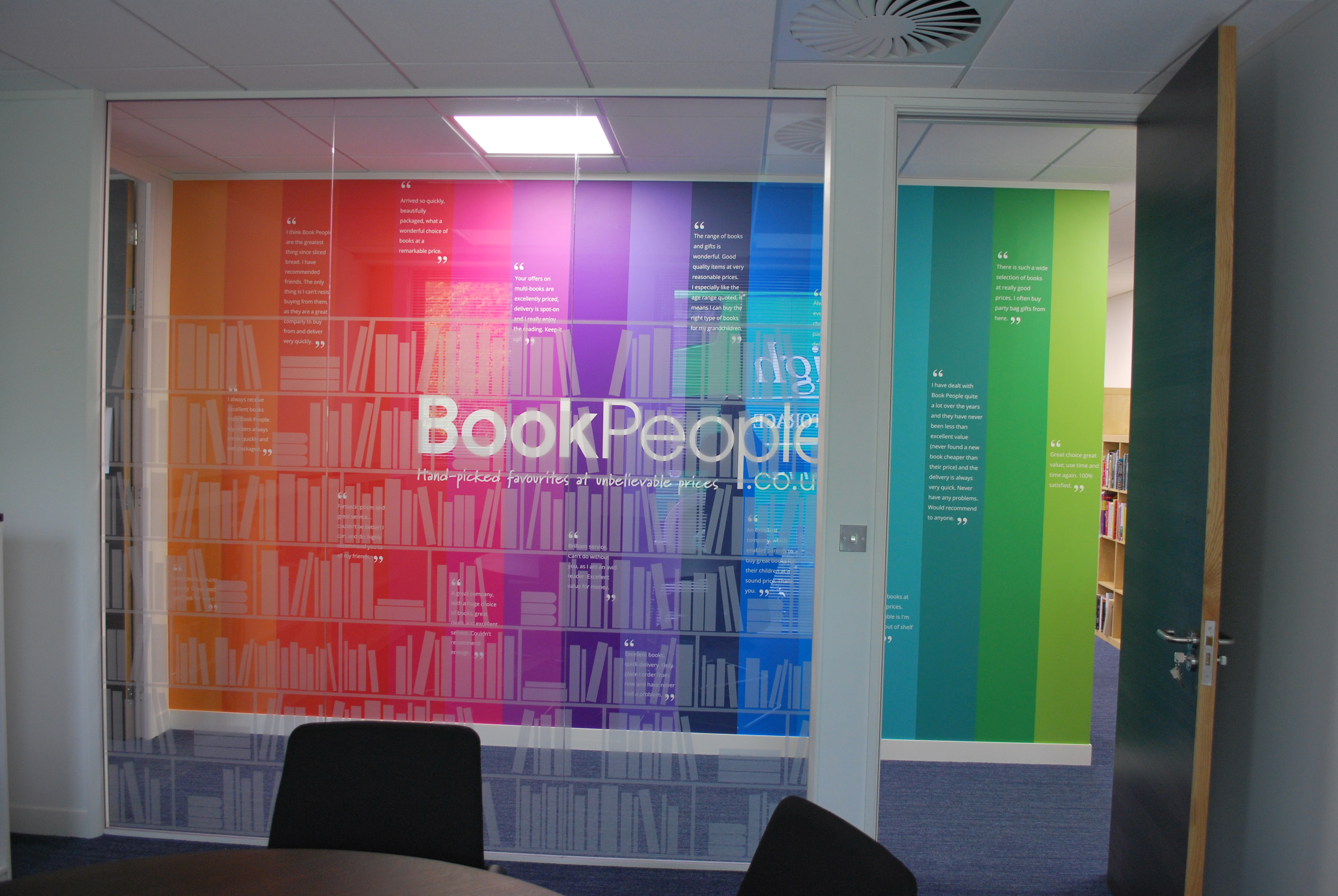 The Book People - multicoloured backdrop wall in new office