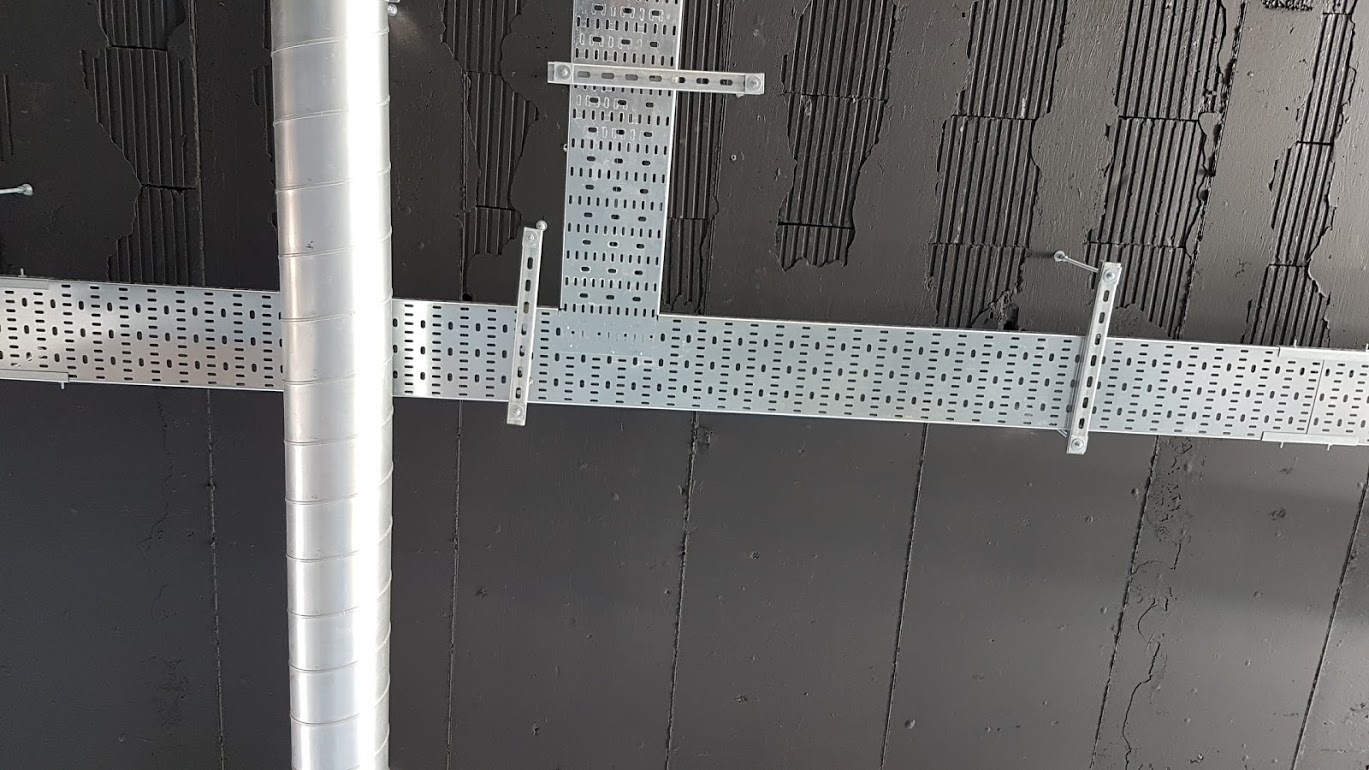 Exposed Duct work on a black ceiling by Novex Solutions