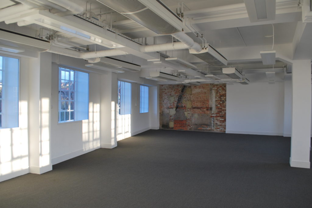 Office with Exposed Ceilings and brick wall