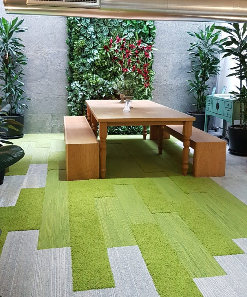 Biophilic design created with a living wall and interface green carpet planks