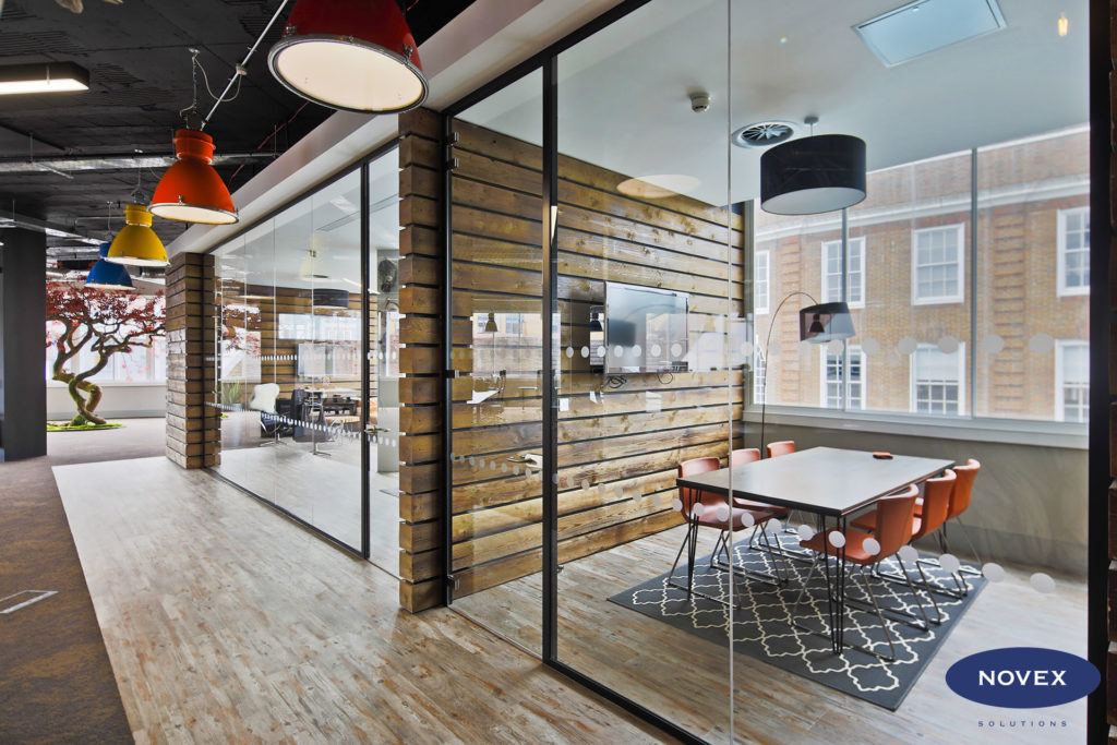 Rustic Timber clad office partitions and full height glass doors - hello games office