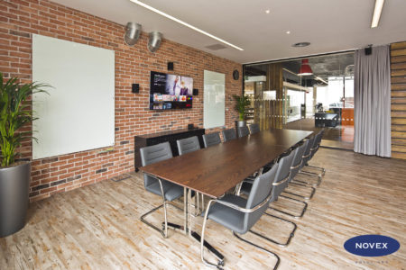 exposed brick wall boardroom with curtains