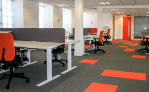 gaming office fit-out with pixelated orange carpet and kinnarps furniture